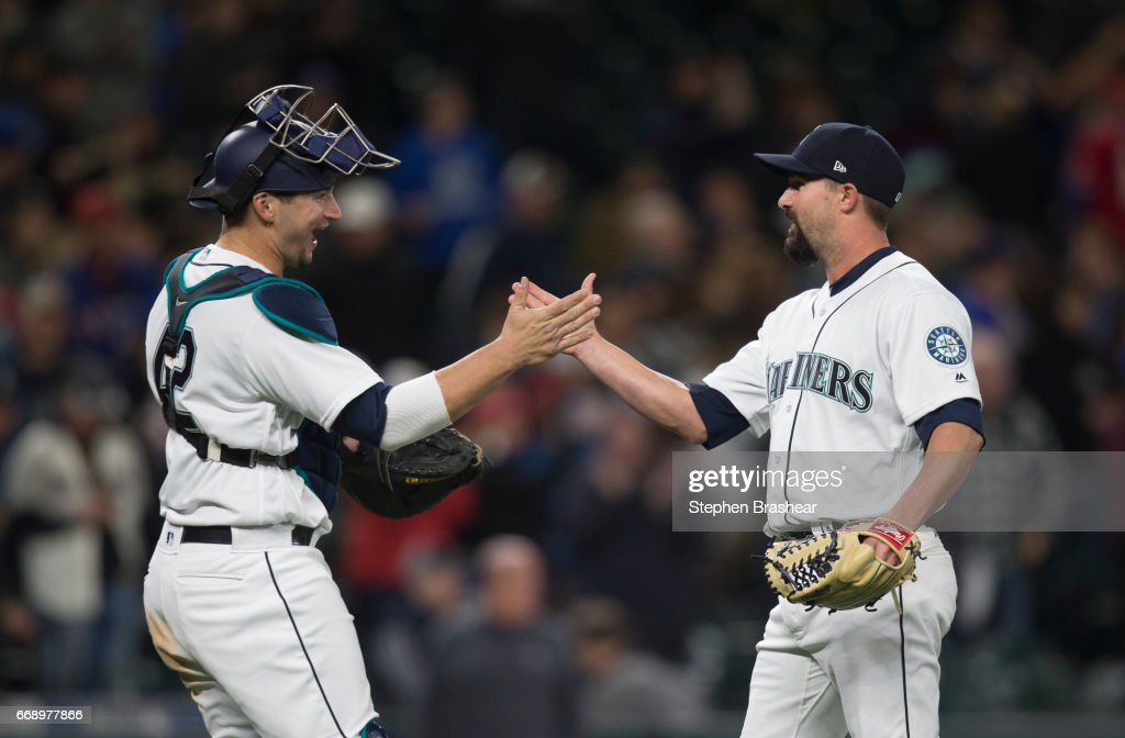 Catcher Mike Zunino #3, left, of the Seattle Mariners and relief pitcher Nick Vincent #50 of the Seattle Mariners celebrate a victory over the against the Texas Rangers in a game at Safeco Field on April 15, 2017 in Seattle, Washington. The Mariners won the game 5-0. All players are wearing #42 in honor of Jackie Robinson Day.