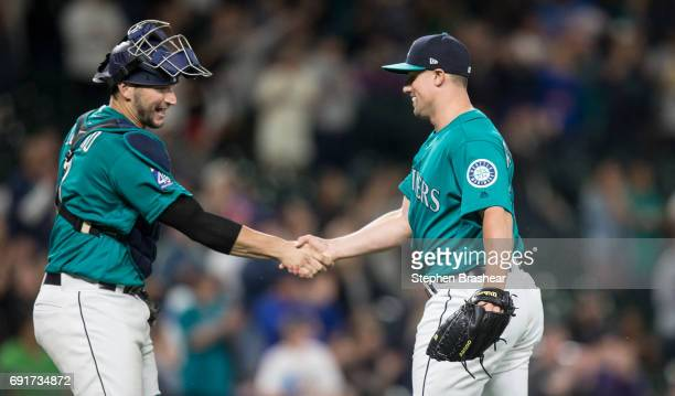 Catcher Mike Zunino of the Seattle Mariners and relief pitcher Dan Altavilla of the Seattle Mariners celebrate after a game against the Tampa Bay...