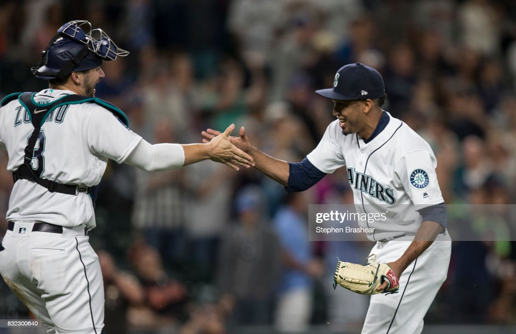 Catcher Mike Zunino #3 of the Seattle Mariners and relief pitcher Edwin Diaz #39 of the Seattle Mariners celebrate after a game against the Baltimore Orioles at Safeco Field on August 15, 2017 in Seattle, Washington. The Mariners won 3-1 and Diaz got the save.