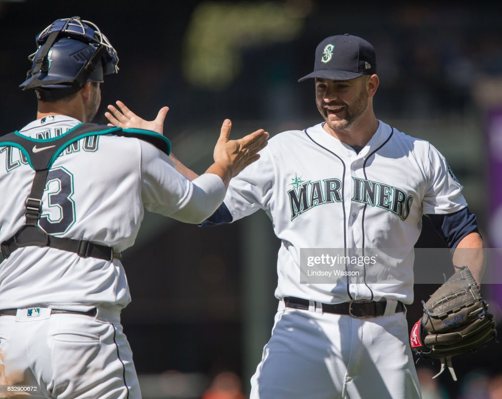 Catcher Mike Zunino #3 of the Seattle Mariners celebrates with Marc Rzepczynski after Rzepczynski struck out Chris Davis of the Baltimore Orioles for the final out at Safeco Field on August 16, 2017 in Seattle, Washington. The Seattle Mariners beat the Baltimore Orioles 7-6.