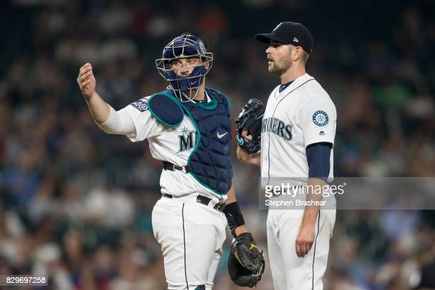 Catcher Mike Zunino of the Seattle Mariners gestures to the dugout for training personnel after meeting at the mound with starting pitcher James...
