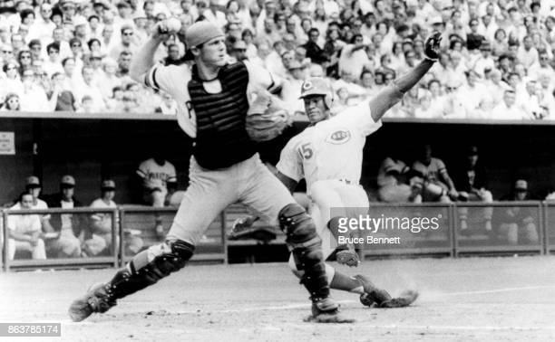 Catcher Milt May of the Pittsburgh Pirates throws to first as George Foster of the Cincinnati Reds is doubled up on the play during an MLB game on...