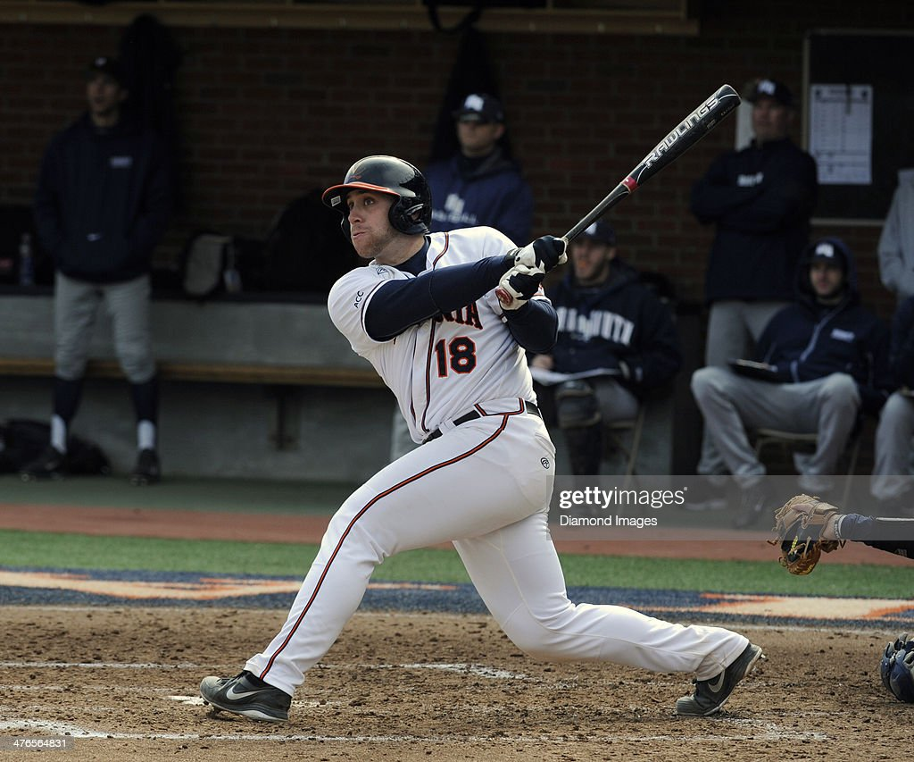 Catcher Nate Irving #18 of the University of Virginia Cavaliers hits a three-run homerun during the bottom of the third inning of a game on March 1, 2014 against the Monmouth University Hawks at Davenport Field on the campus of the University of Virginia in Charlottesville, VA.