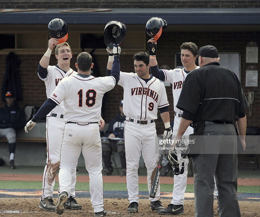 Catcher Nate Irving #18 of the University of Virginia Cavaliers is greeted at homeplate by Joe McCarthy #31, Kenny Towns #9 and Brendon Downes #10 after Irving hit a three-run homerun during the bottom of the third inning of a game on March 1, 2014 against the Monmouth University Hawks at Davenport Field on the campus of the University of Virginia in Charlottesville, VA. Downes and McCarthy scored on the play ahead of Irving.