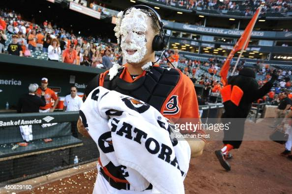 Catcher Nick Hundley of the Baltimore Orioles wears the remnants of a celebratory pie delivered by teammate Adam Jones during a postgame interview...