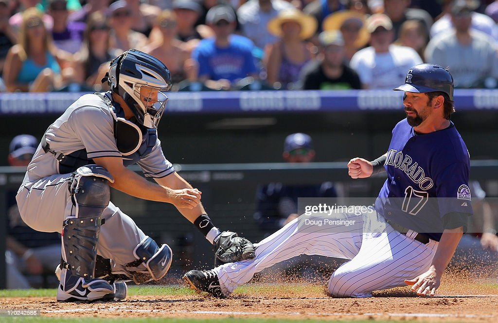 Catcher <a gi-track='captionPersonalityLinkClicked' href=/galleries/search?phrase=Nick+Hundley&family=editorial&specificpeople=4175399 ng-click='$event.stopPropagation()'>Nick Hundley</a> #4 of the San Diego Padres tags out <a gi-track='captionPersonalityLinkClicked' href=/galleries/search?phrase=Todd+Helton&family=editorial&specificpeople=200735 ng-click='$event.stopPropagation()'>Todd Helton</a> #17 of the Colorado Rockies at home as he tries to score on a fly ball by Jonathan Herrera #18 of the Colorado Rockies to leftfield in the second inning at Coors Field on June 9, 2013 in Denver, Colorado.