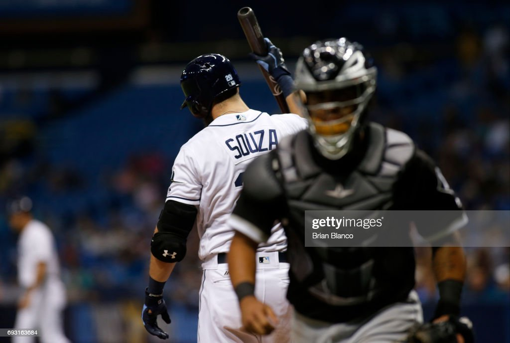 Catcher Omar Narvaez #38 of the Chicago White Sox makes his way to the dugout as Steven Souza Jr. #20 of the Tampa Bay Rays reacts after striking out swinging with two men on base to end the eighth inning of a game on June 6, 2017 at Tropicana Field in St. Petersburg, Florida.