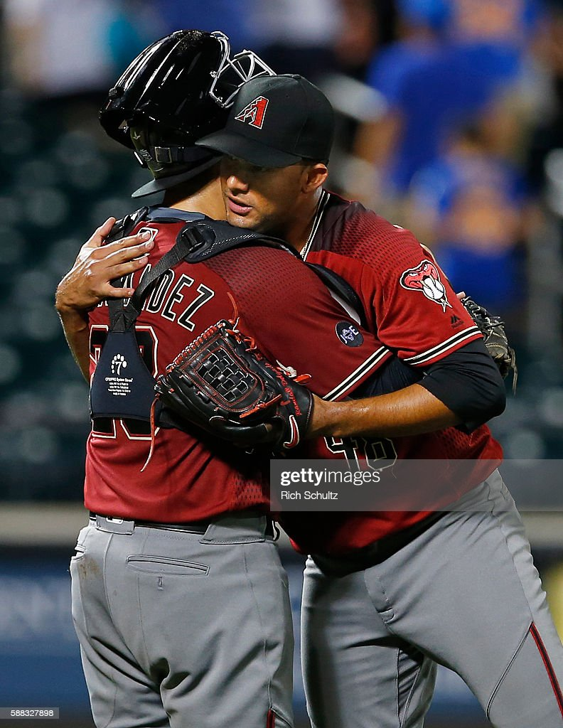 Catcher Oscar Hernandez #28 of the Arizona Diamondbacks is hugged by pitcher Randall Delgado #48 after the Diamondbacks defeated the New York Mets 3-2 in 12 innings during a game at Citi Field on August 10, 2016 in the Flushing neighborhood of the Queens borough of New York City. The Diamondbacks won 3-2.