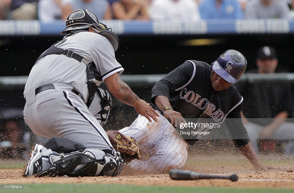 Catcher Ramon Castro #27 of the Chicago White Sox gets a force out on Jonathan Herrera #18 of the Colorado Rockies at home on a bases loaded ground ball by Seth Smith of the Rockies to first baseman Adam Dunn of the White Sox in the third inning during Interleague play at Coors Field on June 30, 2011 in Denver, Colorado.