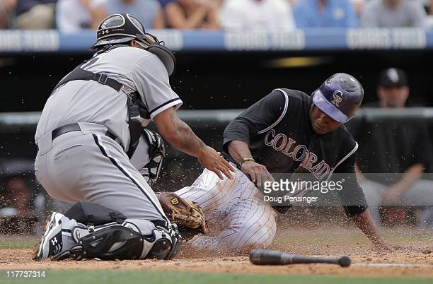 Catcher Ramon Castro of the Chicago White Sox gets a force out on Jonathan Herrera of the Colorado Rockies at home on a bases loaded ground ball by...