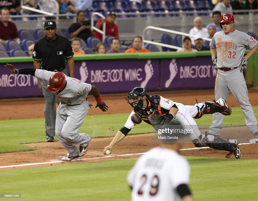 Catcher Rob Brantley #19 of the Miami Marlins puts out Brandon Phillips #4 of the Cincinnati Reds in a run down in the third inning at Marlins Park on May 15, 2013 in Miami, Florida.