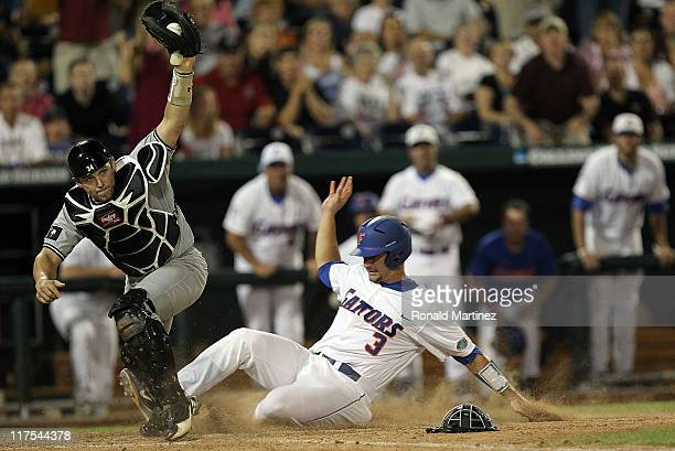 Catcher Robert Beary of the South Carolina Gamecocks makes the out against Mike Zunino of the Florida Gators in the 9th inning during game 1 of the...