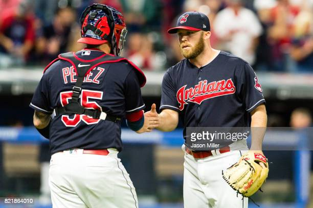 Catcher Roberto Perez of the Cleveland Indians celebrates with closing pitcher Cody Allen after defeating the Cincinnati Reds at Progressive Field on...