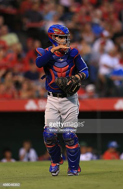 Catcher Robinson Chirinos of the Texas Rangers gestures to the mound after the inning during the MLB game against the Los Angeles Angels of Anaheim...