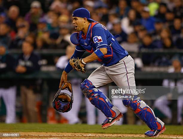Catcher Robinson Chirinos of the Texas Rangers reacts to a bunt against the Seattle Mariners at Safeco Field on April 26 2014 in Seattle Washington