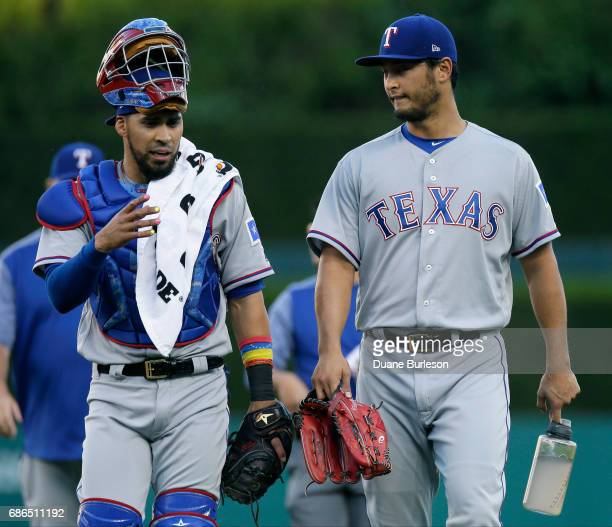 Catcher Robinson Chirinos of the Texas Rangers talks with pitcher Yu Darvish of the Texas Rangers before their game against the Detroit Tigers at...
