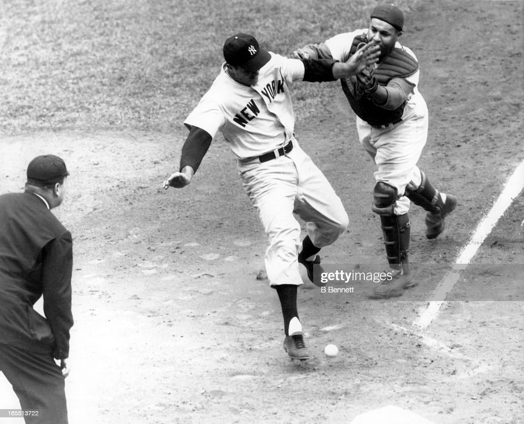 Catcher Roy Campanella #39 of the Brooklyn Dodgers can't handle the ball as Bill 'Moose' Skowron #14 of the New York Yankees scores during Game 3 of the 1955 World Series on September 30, 1955 at Ebbets Field in Brooklyn, New York.