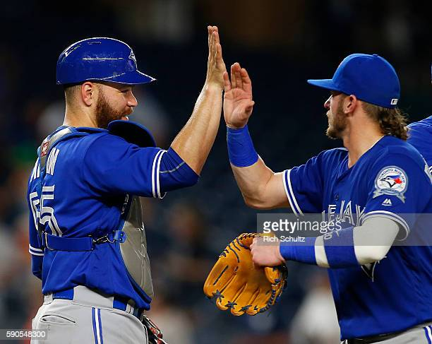 Catcher Russell Martin and Josh Donaldson of the Toronto Blue Jays high five after defeating the New York Yankees 126 at Yankee Stadium on August 16...