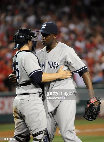Catcher Russell Martin and pitcher Rafael Soriano of the New York Yankees celebrate defeating the Los Angeles Angels of Anaheim 65 at Angel Stadium...