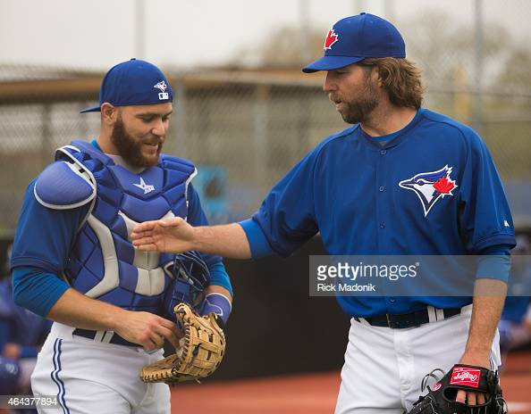DUNEDIN FEBRUARY 25 Catcher Russell Martin gets a playful slap on the chest protector from pitcher RA Dickey following their morning work in the...