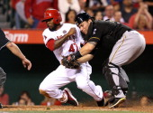 Catcher Russell Martin of the Pittsburgh Pirates tags out Howie Kendrick of the Los Angeles Angels of Anaheim as he tries to score from second base...