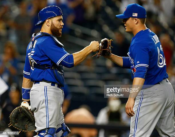 Catcher Russell Martin of the Toronto Blue Jays congratulates Aaron Loup after defeating the New York Yankees 115 in a MLB baseball game at Yankee...