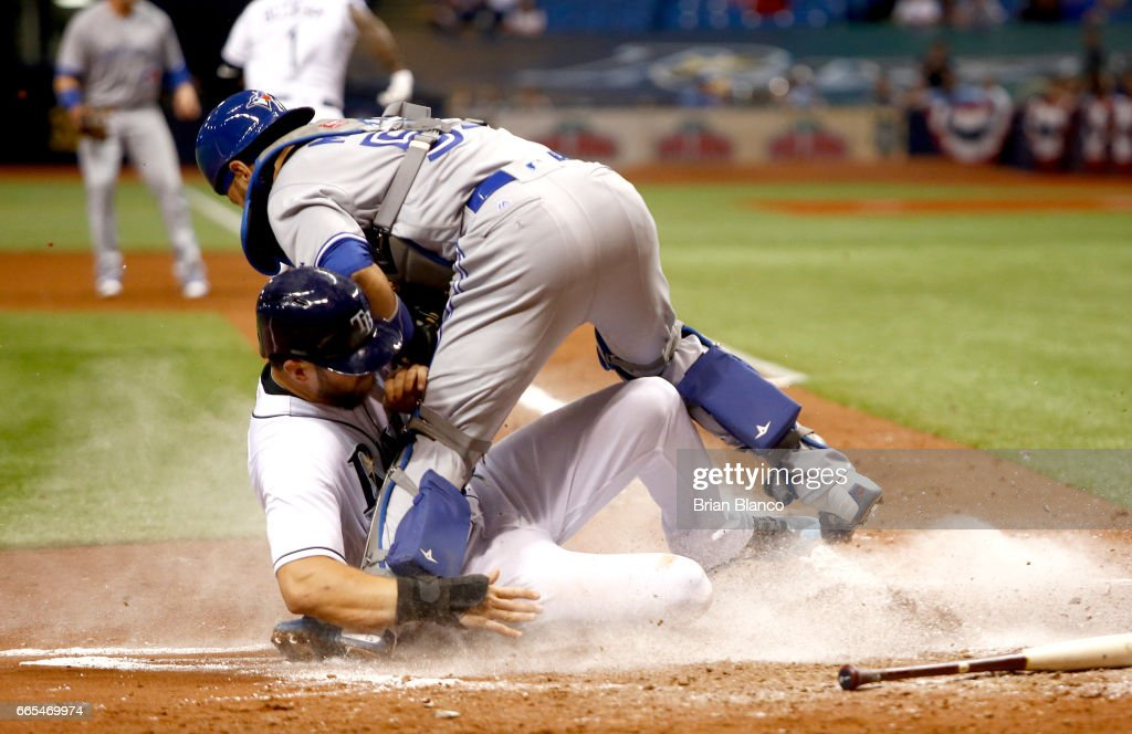 Catcher Russell Martin #55 of the Toronto Blue Jays gets the out at home plate on Steven Souza Jr. #20 of the Tampa Bay Rays as Souza attempts to score off of a fielder's choice by Tim Beckham during the fifth inning of a game on April 6, 2017 at Tropicana Field in St. Petersburg, Florida.