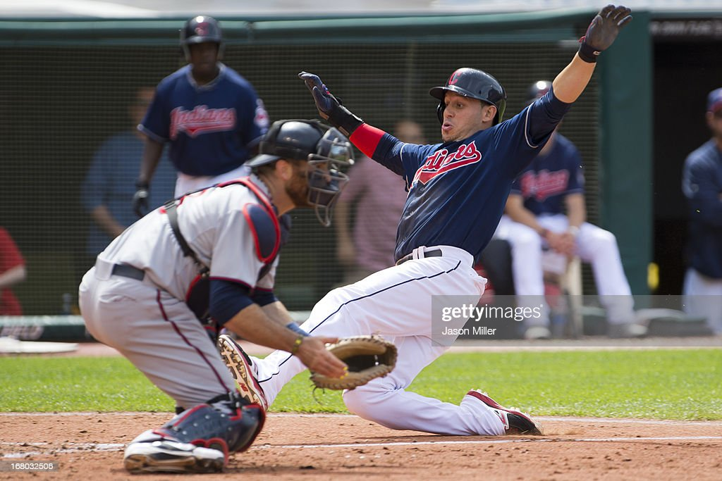 Catcher <a gi-track='captionPersonalityLinkClicked' href=/galleries/search?phrase=Ryan+Doumit&family=editorial&specificpeople=598785 ng-click='$event.stopPropagation()'>Ryan Doumit</a> #9 of the Minnesota Twins waits for the throw as <a gi-track='captionPersonalityLinkClicked' href=/galleries/search?phrase=Asdrubal+Cabrera&family=editorial&specificpeople=834042 ng-click='$event.stopPropagation()'>Asdrubal Cabrera</a> #13 of the Cleveland Indians is safe at home during the seventh inning at Progressive Field on May 4, 2013 in Cleveland, Ohio.