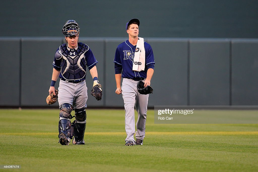 Catcher Ryan Hanigan #24 and starting pitcher Drew Smyly #33 of the Tampa Bay Rays walk in from the bull pen before the start of their game against the Baltimore Orioles at Oriole Park at Camden Yards on August 27, 2014 in Baltimore, Maryland.