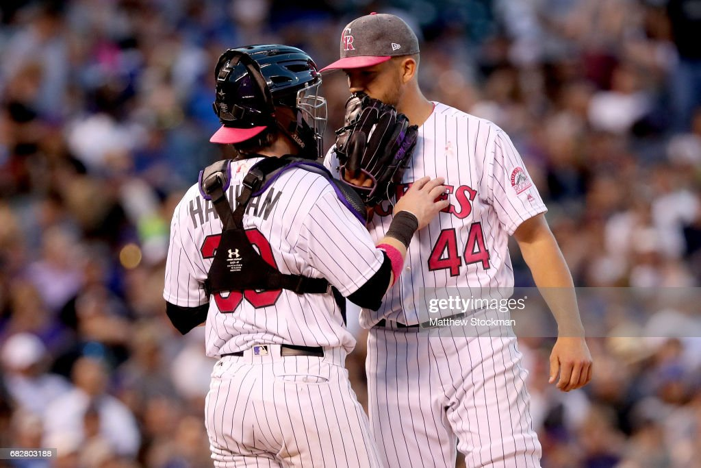 Catcher Ryan Hanigan #30 and starting pitcher Tyler Anderson #44 of the Colorado Rockies confer in the sixth inning against the Los Angeles Dodgers at Coors Field on May 13, 2017 in Denver, Colorado. Members of both teams were wearing pink in commemoration of Mother's Day weekend.