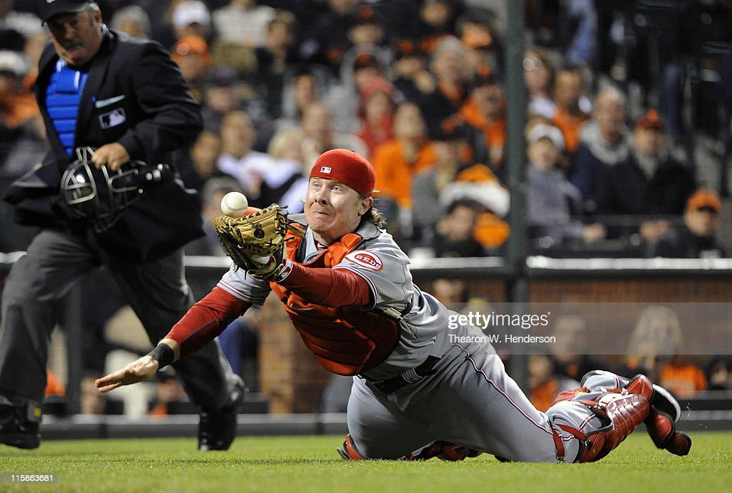 Catcher <a gi-track='captionPersonalityLinkClicked' href=/galleries/search?phrase=Ryan+Hanigan&family=editorial&specificpeople=833982 ng-click='$event.stopPropagation()'>Ryan Hanigan</a> #29 of the Cincinnati Reds dives but can't catch this foul pop-up off the failed bunt attempt from Ryan Vogelsong #32 of the San Francisco Giants during a MLB baseball game June 10, 2011 at AT&T Park in San Francisco, California.