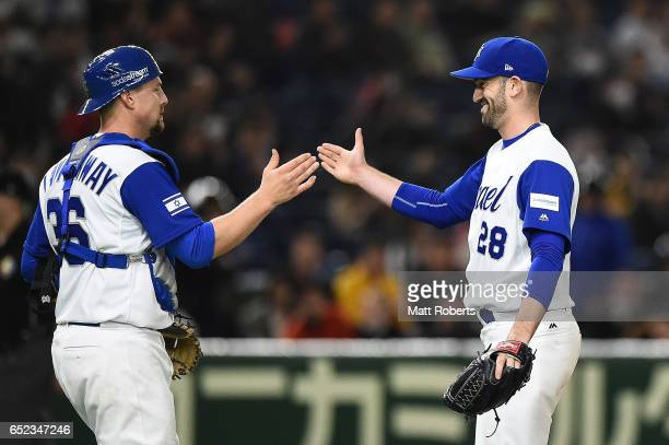 Catcher Ryan Lavarnway of Israel and pitcher Josh Zeid of Israel celebrate after winning the World Baseball Classic Pool E Game One between Cuba and...