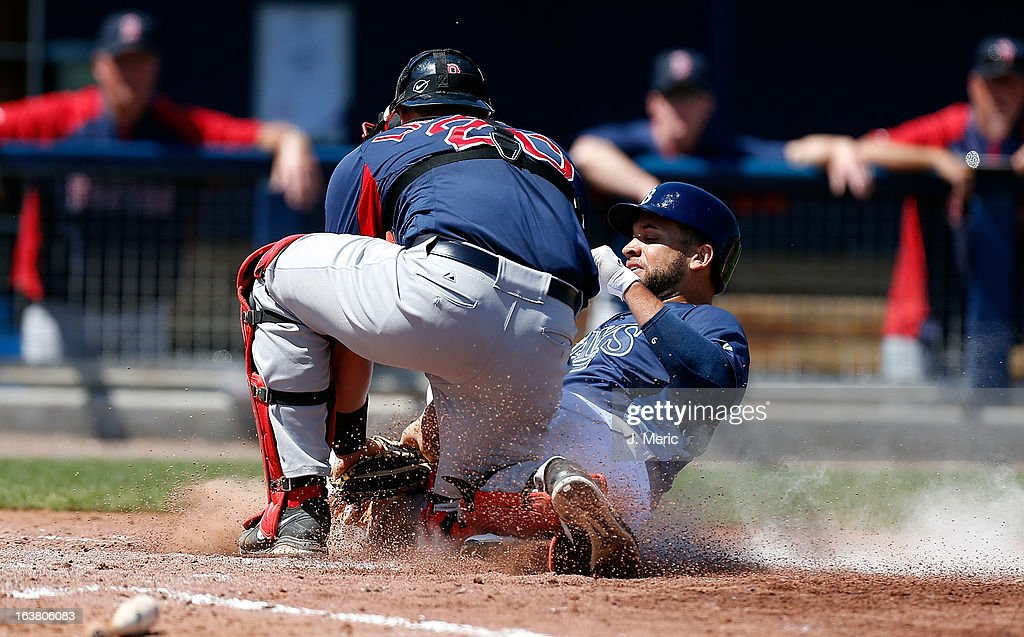 Catcher Ryan Lavarnway #20 of the Boston Red Sox tags out first baseman James Loney #21 of the Tampa Bay Rays as he tried to score from third during a Grapefruit League Spring Training Game at the Charlotte Sports Complex on March 16, 2013 in Port Charlotte, Florida.