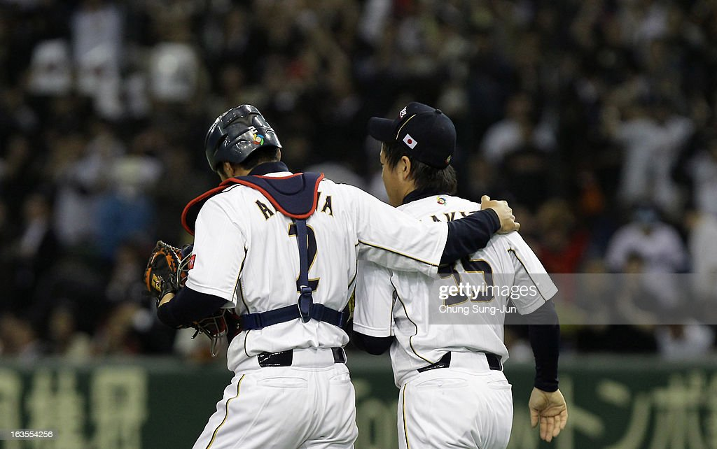 Catcher Ryoji Aikawa #2 and pitcher Kazuhisa Makita #35 of Japan celebrate victory over Netherlands in the World Baseball Classic Second Round Pool 1 game between Japan and the Netherlands at Tokyo Dome on March 12, 2013 in Tokyo, Japan.