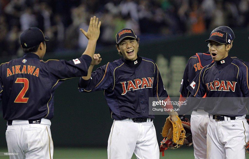Catcher Ryoji Aikawa #2, infielders Hayato Sakamoto #6 and Takashi Toritani #1 celebrate victory over Chinese Taipei in the World Baseball Classic Second Round Pool 1 game between Japan and Chinese Taipei at Tokyo Dome on March 8, 2013 in Tokyo, Japan.