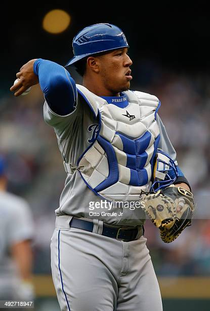 Catcher Salvador Perez of the Kansas City Royals asks for a new ball after a visit to the mound during the game against the Seattle Mariners at...