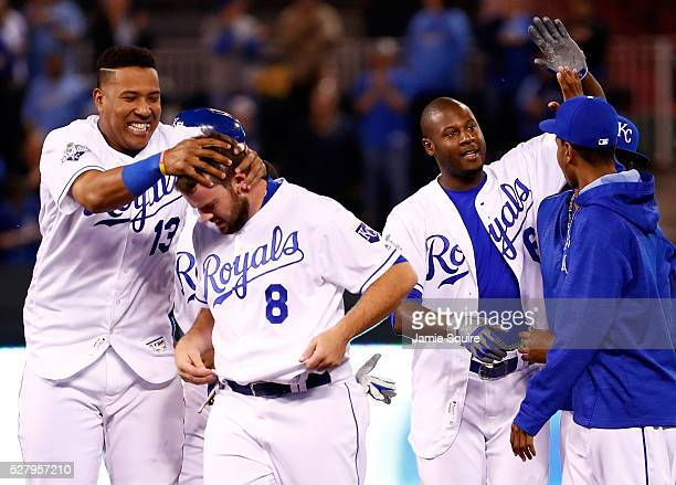 Catcher Salvador Perez of the Kansas City Royals celebrates with Mike Moustakas and Lorenzo Cain after Cain hit the gamewinning single in the bottom...