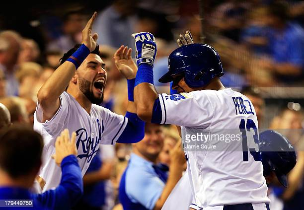 Catcher Salvador Perez of the Kansas City Royals is congratulated by Eric Hosmer after hitting a home run during the 4th inning of the game against...