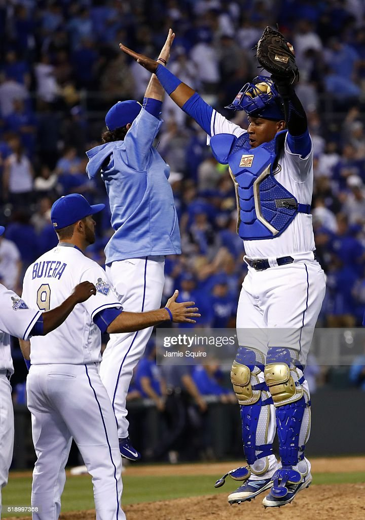Catcher Salvador Perez #13 of the Kansas City Royals leaps to high five pitcher <a gi-track='captionPersonalityLinkClicked' href=/galleries/search?phrase=Tim+Collins+-+Baseball&family=editorial&specificpeople=8616741 ng-click='$event.stopPropagation()'>Tim Collins</a> #55 after the Royals defeated the New York Mets 4-3 to win their opening day game at Kauffman Stadium on April 3, 2016 in Kansas City, Missouri.