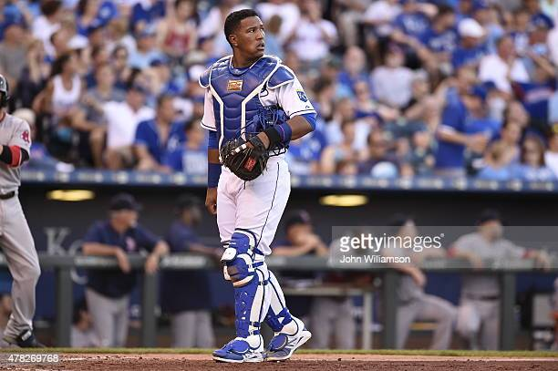 Catcher Salvador Perez of the Kansas City Royals looks at the scoreboard as he returns to his position behind home plate during a timeout in the game...
