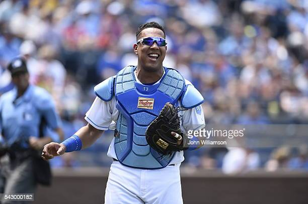 Catcher Salvador Perez of the Kansas City Royals smiles as the first baseman makes the catch of a foul fly ball in the game against the Detroit...