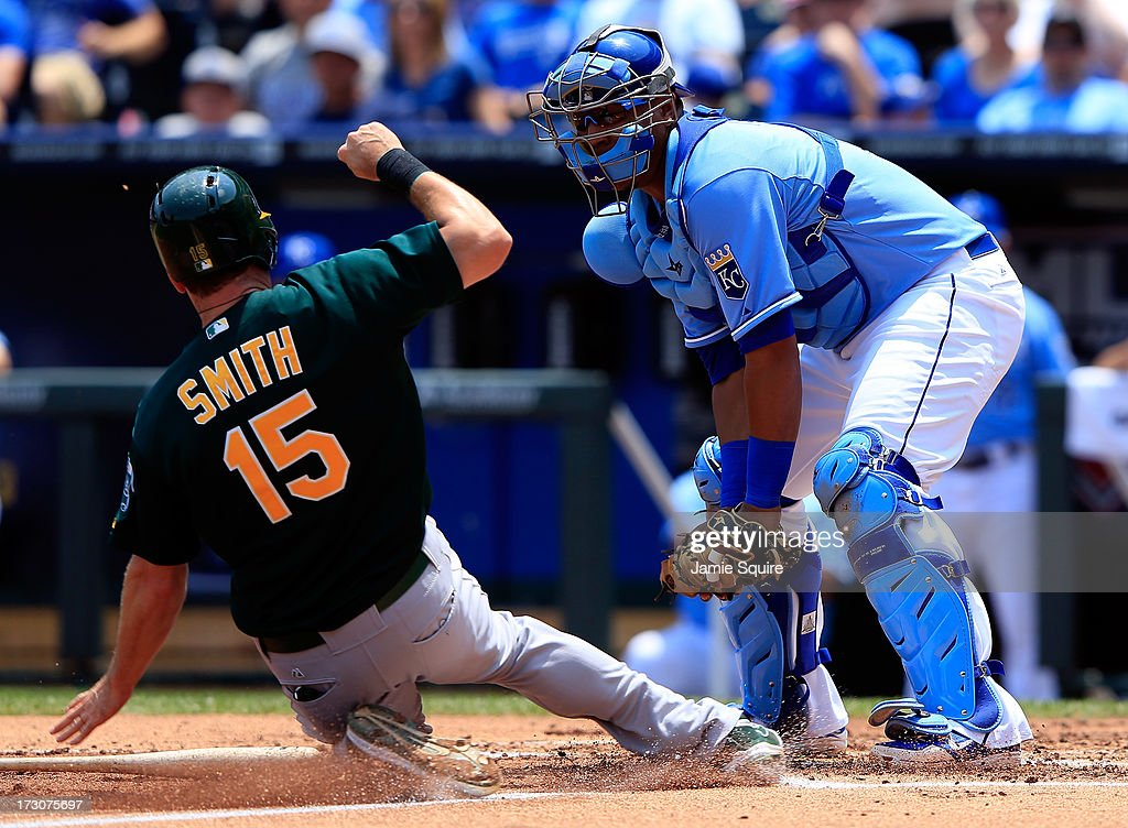 Catcher Salvador Perez #13 of the Kansas City Royals tags out <a gi-track='captionPersonalityLinkClicked' href=/galleries/search?phrase=Seth+Smith&family=editorial&specificpeople=3190174 ng-click='$event.stopPropagation()'>Seth Smith</a> #15 of the Oakland Athletics at home plate while trying to score during the 2nd inning of the game at Kauffman Stadium on July 6, 2013 in Kansas City, Missouri.
