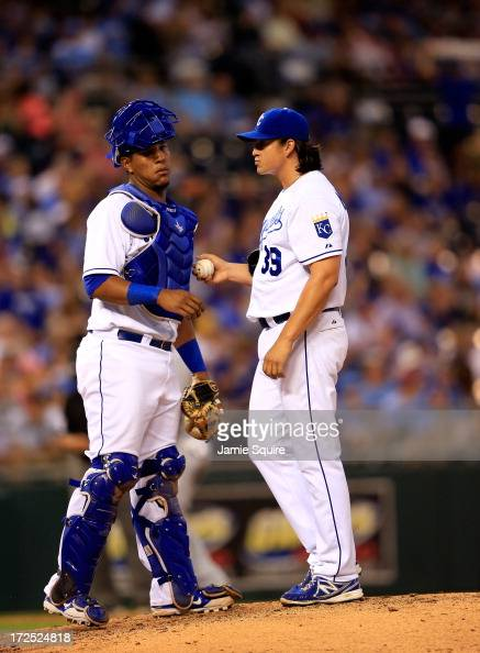 Catcher Salvador Perez of the Kansas City Royals talks with pitcher Luis Mendoza on the mound during the game against the Cleveland Indians at...