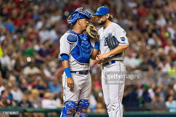 Catcher Salvador Perez of the Kansas City Royals talks with relief pitcher Luke Hochevar of the Kansas City Royals at Progressive Field on July 13...