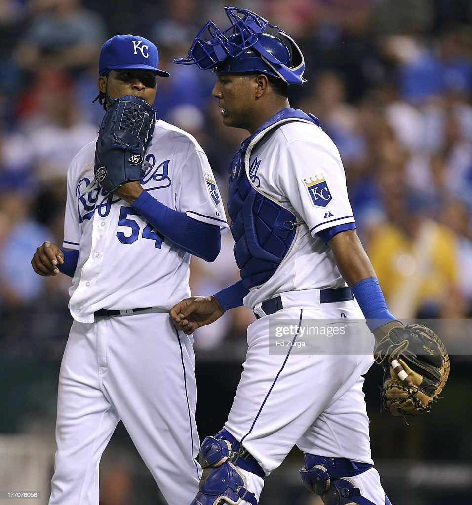 Catcher Salvador Perez #13 of the Kansas City Royals talks with starting pitcher <a gi-track='captionPersonalityLinkClicked' href=/galleries/search?phrase=Ervin+Santana&family=editorial&specificpeople=243096 ng-click='$event.stopPropagation()'>Ervin Santana</a> #54 during the fourth inning during a game against the Chicago White Sox at Kauffman Stadium August 20, 2013 in Kansas City, Missouri.