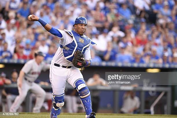 Catcher Salvador Perez of the Kansas City Royals throws to first base for an out after fielding a weakly hit ground ball in the game against the...