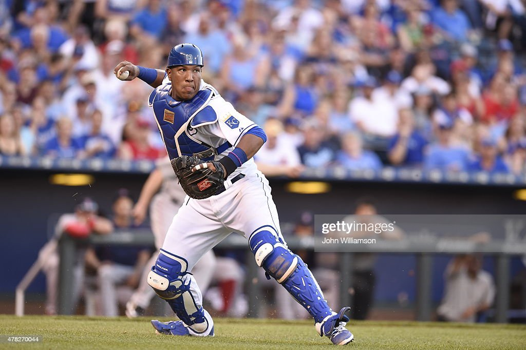Catcher Salvador Perez #13 of the Kansas City Royals throws to first base for an out after fielding a weakly hit ground ball in the game against the Boston Red Sox on June 20, 2015 at Kauffman Stadium in Kansas City, Missouri. The Kansas City Royals defeated the Boston Red Sox 7-4.