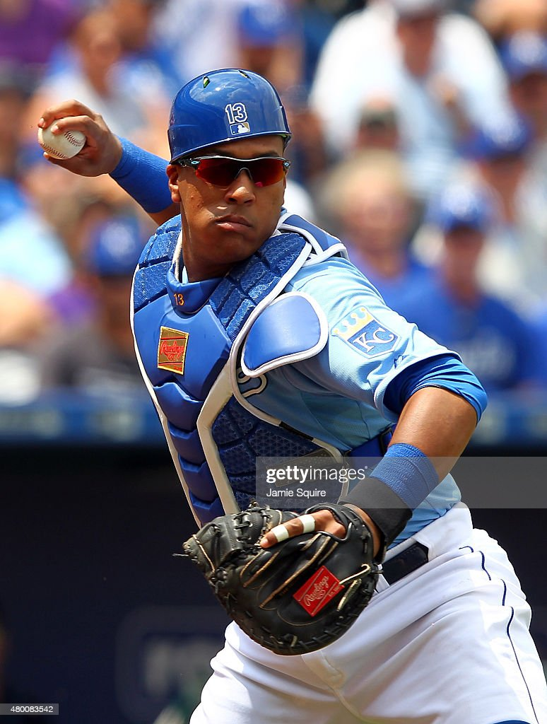 Catcher Salvador Perez #13 of the Kansas City Royals throws toward first during the game against the Tampa Bay Rays at Kauffman Stadium on July 9, 2015 in Kansas City, Missouri.