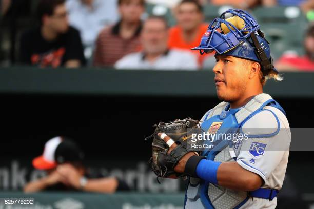 Catcher Salvador Perez of the Kansas City Royals waits for a pitch against the Baltimore Orioles in the second inning at Oriole Park at Camden Yards...