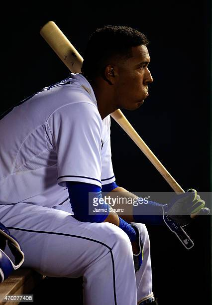 Catcher Salvador Perez of the Kansas City Royals watches from the dugout during the game against the Oakland Athletics at Kauffman Stadium on April...